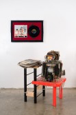 Justin Lieberman<br /> <i>Theme and Novelty Record Collection with Butcher Block Album Placeholder</i>, 2008<br /> Mixed media<br /> Collection: 43 x 27 x 31 inches  109.2 x 68.6 x 78.7 cm<br /> Placeholder: 22 x 32.5 inches  55.9 x 82.6 cm