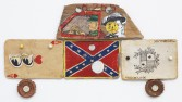 Kristen Morgin<br /> <i>General Lee</i>, 2013<br /> Unfired clay, paint, ink, wire, 5 nails<br /> 6 x 10 x 1/4 inches<br /> 15.2 x 25.4 x .6 cm