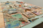 Kristen Morgin<br /> <i>The Repeating Table</i> (detail), 2010<br /> Wood, books, toys, records with clay painted counterparts<br /> 45 x 68 x 108 inches<br /> 114.3 x 172.7 x 274.3 cm