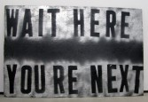 Mark Flood<br /> <i>WAIT HERE</i>, 2010<br /> Spray paint on plywood<br /> 29.75 x 49.5 inches<br /> 75.6 x 125.7 cm